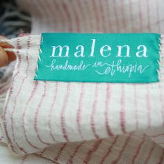 First glimpse of our Scout Collection, and our Malena scarf tags! www.malena.com  Photo by: Patty Kirby  Design by: Virginia Lucas Hart