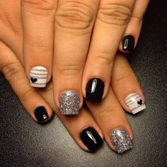 This manicure features the acrylic powder applied on a black and silver nail polish to achieve the nail art. See the fab products used to create this look.