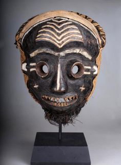 """Africa   """"Mbangu"""" Mask from the Pende people of DR Congo   ca. early 1900s   Wood, raffia, fiber, natural pigments, kaolin"""