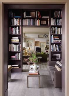 Contemporary Office/Library and Janson Goldstein in New York, New York Bookshelves by Janson Goldstein frame a view of the living room in a Manhattan penthouse by architecture firm Janson Goldstein. The library's 1940s Italian cocktail table was found at Mondo Cane, and the flooring is stained European oak.
