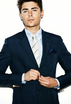 I simply fall to pieces when a guy wears a suit and tie, classy! Yummy