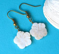 White Carved Mother of Pearl Flowers . Earrings by MerelaniDesigns, $0.20