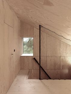 I'm over the plywood walls, but love the net railing Savioz Fabrizzi Architects Stairwell | Remodelista