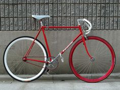 We love the bright red frame on this fixed-gear Panasonic commuter Fixi Bike, New Bicycle, Fixed Gear Bicycle, Retro Bike, Bicycle Accessories, Bike Frame, Bicycle Design, Road Bikes, Vintage Bicycles