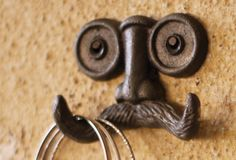 Quirky Mustache Hook - From Antiquefarmhouse.com - http://www.antiquefarmhouse.com/past/quirky-accents/mustache-hook.html