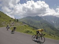Britain's Chris Froome (in the yellow jersey) speeds through the Pyrenees on his way to winning his first career Tour de France. Chris Froome, Wide World, Pro Cycling, Group Tours, World Of Sports, Sports Photos, Belle Photo, Great Britain, Ireland