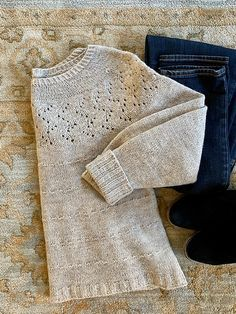 Sweater knitting pattern: Ariadne by JoannaN Designs. Ariadne is knitted in the round, from top down with circular yoke increases and seamless construction. The subtle lace around the yoke and the textured stripes add interesting notes to the sweater. Sweater Knitting Patterns, Lace Knitting, Knitting Stitches, Knit Patterns, Pull Crochet, Knit Crochet, Crochet Cats, Crochet Birds, Crochet Food