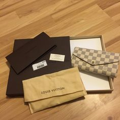Louis Vuitton Sarah wallet Damier Azur Like new This was used for one week. No stains, rips, holes, or tears. Like new condition. I did put cards in slots so those are slightly stretched but that would be the only sign of wear. Comes with dust bag, box, and tags. Bought December 26, 2015 at southpark mall in Charlotte NC.   7.5 x 3.9 inches  (Length x Height)   - Calf leather lining - 16 credit card slots, two large compartments for banknotes, zippered coin pocket, two flat interior pockets…