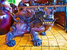 Photograph I shot in Okinawa, Japan. Took the Photographs in Okinawa, Japan. They Must be Okinawan lion dogs .  Shisa , Like the komainu are variation of the guardian lion from China. Traditionally to ward off evil spirits.