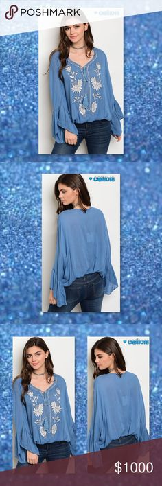 """JUST IN🆕Blue Boho Embroidery Peasant Top New Scoop Neck Long Bell Sleeve Peasant Top, WIth Embroidered Detail And Front Tie Up Manufactured in CHINA Material: 100% RAYON Size: Small, Medium, Large Fits true to size Loose Boho style fit  Approx flat measurements taken from Small: Bust: 18"""" Waist:17"""" Length: 28"""" L: 28"""" B: 18"""" W: 17""""   ⭐️⭐️SORRY NO TRADES AND LOWBALL OFFERS WILL BE IGNORED ⭐️⭐️  ✂️LOWBALL OFFERS WILL BE IGNORED✂️ Glam Squad 2 You Tops"""