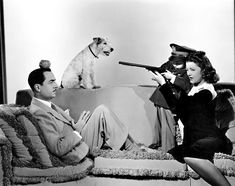 """William Powell, Myrna Loy, Dickie Hall, and Asta the terrier from the 1941 movie """"Shadow of the Thin Man"""""""