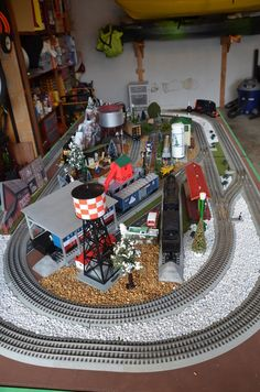 layout on custom built table for garage. Ho Scale Train Layout, Model Train Layouts, Model Trains, Toy Trains, Lionel Trains Layout, Model Railway Track Plans, Train Room, Train Table, Electric Train