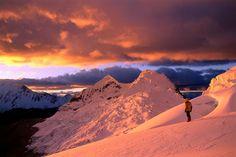 Cordillera Blanca range, Peru  Climber on orange-tinted glacier above Ishinca Valley at sunset, Cordillera Blanca range.