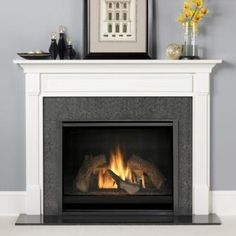I never thought I like grey but the light grey wall behind the fireplace is soft and light.