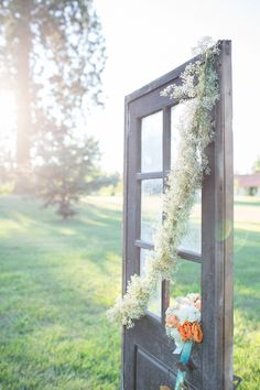 Vintage door for a French chateau inspired shoot. Photography by bubblerock.co.nz  Read more - http://www.stylemepretty.com/2013/08/26/french-chateau-wedding-inspiration-from-bubblerock/