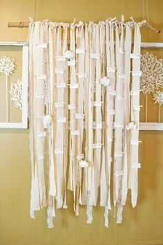 DIY I think lace and burlap would be cool ...drape strips of fabric on a rod and clothespin escort cards to it