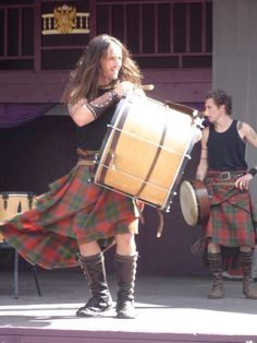 Apparently these are guys from a band called Albannach. All I say is, 'long haired guy in wind-blown kilt.' That's all I need to know.