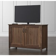 """Shop Ainsworth Walnut 47"""" Media Console with Glass/Wood Doors. The media console offers a choice of door panels, allowing the piece to transition from open to closed storage. Cutouts provide plenty of cord management for media components."""