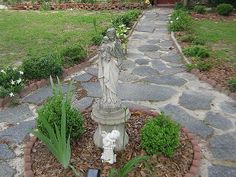 Do a round planter in the middle of the walkway to keep mint from spreading recycled parking lot into walkway