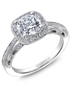 Engagement Rings :   Illustration   Description   Platinum engagement ring with cushion halo mounting and round diamonds down the shank I Style: M2611R310 I by Scott Kay I knot.ly/6490BCXsO    -Read More –   - #WeddingRings https://adlmag.net/2017/12/17/engagement-rings-platinum-engagement-ring-with-cushion-halo-mounting-and-round-diamonds-down-the/