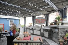 Check out this amazing deck, outdoor kitchen, fireplace, and patio cover!