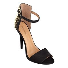"""Roadie is a classic ankle strap high-heel sandal with a bevy of """"don't mess with me"""" golden spikes peppering the backs."""