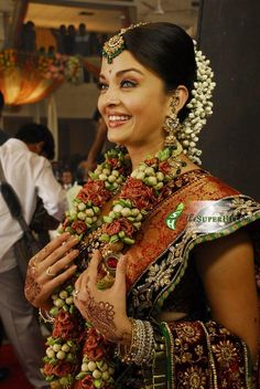 Bollywood and South Indian actress Aishwarya Rai in beautiful maroon designer bridal saree with heavy embroidered and gold zari work paired with designer saree blouse. Actress Aishwarya Rai, Aishwarya Rai Bachchan, Bollywood Actress, Mangalore, Indian Dresses, Indian Outfits, Wedding Sari, Wedding Scene, Bollywood Wedding