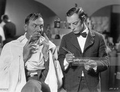 Buster Keaton (right) plays an untrained barber opposite Karl Dane (1886 - 1934) in the film 'Country Dance'. The film, alternatively titled 'Brotherly Love', was directed by J Lee Thompson for MGM.