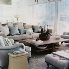 Muted greys whites blues with some vibrant walls and decorations.