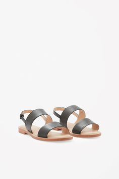 Made from panels of smooth buttery leather, these simple sandals have a slim wooden sole with an adjustable ankle strap fastening and a full padded leather sole for ultimate comfort.