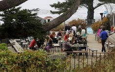 Guests, volunteers and staff gather during lunch on the outdoor dining deck, at Esalen Institute in Big Sur, Calif., on Wednesday September 12, 2012.  The Institute is celebrating it's 50th anniversary this year. Photo: Michael Macor, The Chronicle / SF