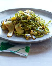 Spinach Fettuccine with Tangy Grilled Summer Squash: At her restaurant, Amanda Cohen tosses herb fettuccine with pickled squash blossoms and grilled zucchini. This simplified recipe features squash that's pickled and then grilled, plus freshly sautéed squash.
