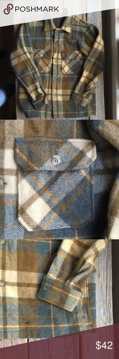 Vintage Woolrich Shirt Jacket This is in great condition for a piece of this vintage. This is a beautiful Plaid wool shirt jacket. They don't make things to last like this today. This is a great piece for any closet. There is a small hole on front right (see picture). This is not going to unravel. Woolrich Jackets & Coats