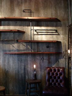 "Awesome shelves made by Jordan Waraksa out of salvaged steel pipe fittings and reclaimed redwood from a 20-foot muscatel wine fermentation barrel. ""When the boards were being disassembled from the Wisconsin Liquor Warehouse in 1967, crowbars were used to pull the dowel joinery apart. These marks, along with nail holes and original wine soaked dowels add to the preservation and history behind each piece."""