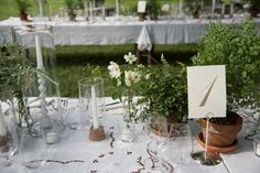 Instead of going with a theme, most of our decisions complemented the feel of the farm. Ferns, cosmos, creeping vines cut from nearby foliage, heirloom Battenburg tablecloths, and mid-century wooden candlesticks decorated each seat.