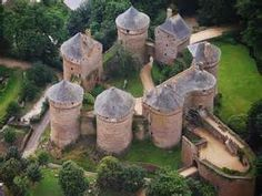 France, Mayenne, Chateau de Lassay - aerial view showing the 8 massive towers connected by curtain walls topped walls, niches and battlements. open for touring