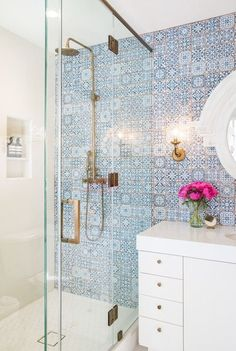 Design your bathroom with pattern in mind for a more modern and sophisticated look. Going for originality? Steer clear of tiling your bathroom in just one colour. Let your creative juices flow by adding a feature wall of patterned tiles just like the statement wall in your bedroom and watch the room come to life.
