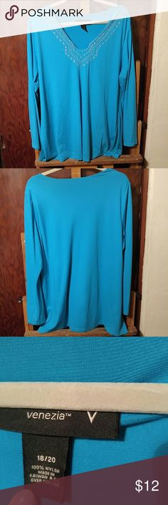 Turquoise Long Sleeve Tunic Gem-toned blue with silver embroidery at neckline. Lightweight, but long sleeved. V-neck. 100% nylon. Venezia from Lane Bryant.  Size 18/20. True to size but stretchy. EUC.  Gorgeous color and neckline embellishment and very figure flattering. Lightweight enough even for warmer weather. Venezia Tops Tunics