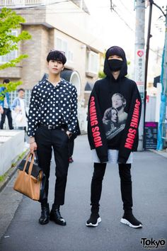 In Harajuku, we met 19-year-old student Minho and 21-year-old singer Ryo. Our attention was caught with their individual black fashion street styles. Minho (at the right), is wearing a grey shirt underneath a Vetements hoodie sweater, black skinny pants from an unknown Korean brand, and a pair of black high top sock trainers from Balenciaga. He is carrying a Louis Vuitton bag (not in photo) and his only accessory is a black mask that covers his nose and mouth. Minho's favorite brands/shops…