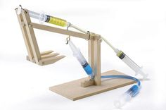 Hydraulic Machines Pack is part of Hydraulic Machines Pack Home Science Tools - The Hydraulic Machines Pack brings four wooden machines to life with hydraulic power Build a platform lifter, scissor lift, cherry picker & excavator Physics Projects, Science Projects For Kids, Engineering Projects, Stem Projects, Science Experiments Kids, Science Fair, Science For Kids, School Projects, Physical Science