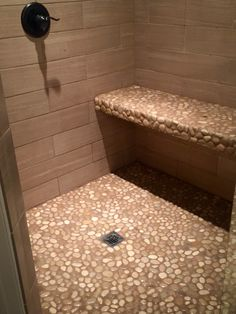 Glazed Tan Pebble Tile Shower Floor and Bench