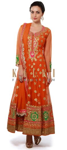 Buy Online from the link below. We ship worldwide (Free Shipping over US$100). Product SKU - 312614. Product Price - $349.00. Product link - http://www.kalkifashion.com/orange-anarkali-suit-enhanced-in-gotta-patch-embroidery-only-on-kalki.html