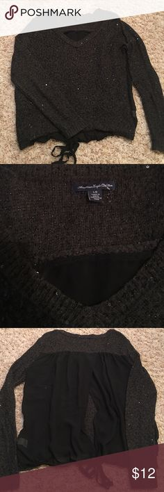 AE Sequins Sweater Super cute sweater with sheer back that opens! This is so adorable! Needs to go to someone who will get more use out of it. Size large. Excellent condition!! American Eagle Outfitters Sweaters Crew & Scoop Necks