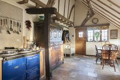 The bold blue AGA stands out and keeps the kitchen cosy #interiors #WTinteriors