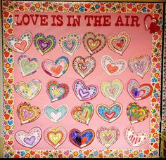 Valentine's Day bulletin board. Let each student decorate a heart & hang. Super easy!