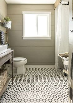 120 Modern Farmhouse Bathroom Design Ideas And Remodel. You don't need to live on a farm to enjoy farmhouse style. Retro and rustic, the farmhouse style takes us to simpler times, where technology . Bathroom Tile Designs, Bathroom Floor Tiles, Wood Bathroom, Small Bathroom, Bathroom Black, Bathroom Ideas, Classic Bathroom, Bath Ideas, Restroom Ideas