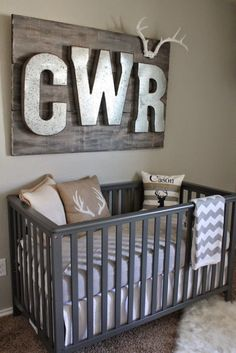 Hunting and Fishing Themed Nursery - we love the rustic look of the galvanized letters over the crib!