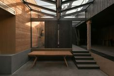 Restaurant Ya / C+ Architects Glass Restaurant, Restaurant Design, Rammed Earth Wall, Timber Table, Black Dining Chairs, Stone Columns, Small Courtyards, Concrete Steps, Through The Roof