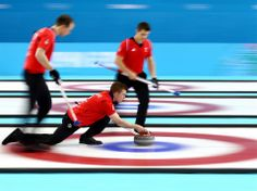 Greg Drummond of Great Britain releases the stone during the Curling Men's Round Robin match between Great Britain and Norway on day 10