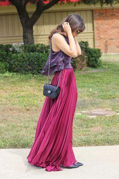 Shop this look on Lookastic:  http://lookastic.com/women/looks/hot-pink-maxi-skirt-violet-tank-black-crossbody-bag-black-pumps/6232  — Hot Pink Pleated Maxi Skirt  — Violet Paisley Tank  — Black Quilted Leather Crossbody Bag  — Black Leather Pumps